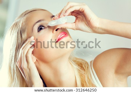 Young lovely woman dripping eyes at home
