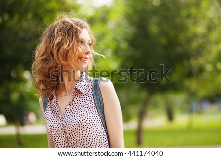 Young lovely woman in city park