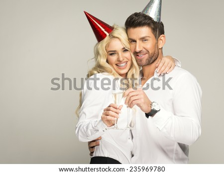 Young lovers celebrating  - stock photo