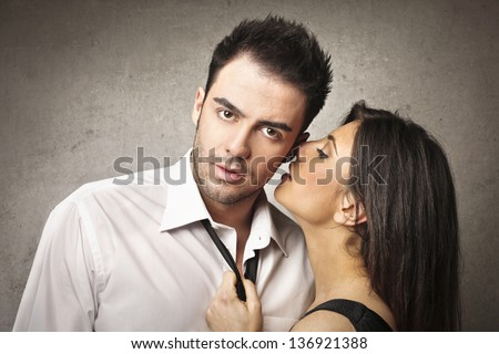 young lovers share secrets - stock photo