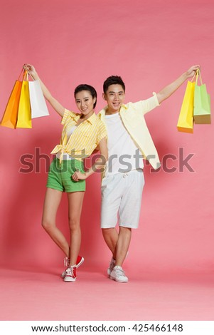 Young lovers shopping - stock photo