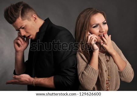 Young lovers talking on the phone - stock photo