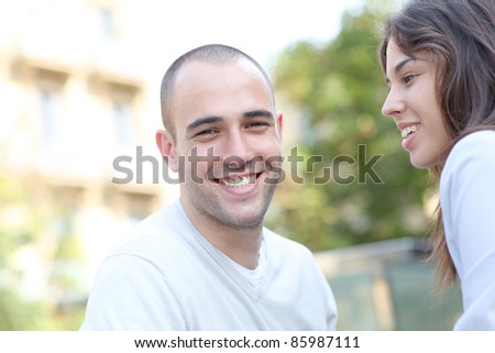 Young lovin couple in town - stock photo