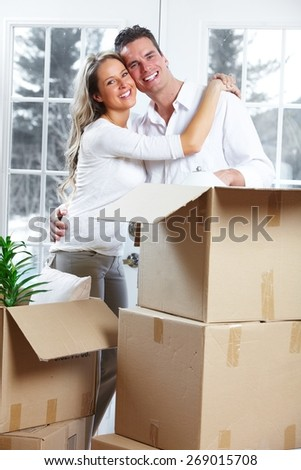 Young loving couple at new home. Relationship. - stock photo