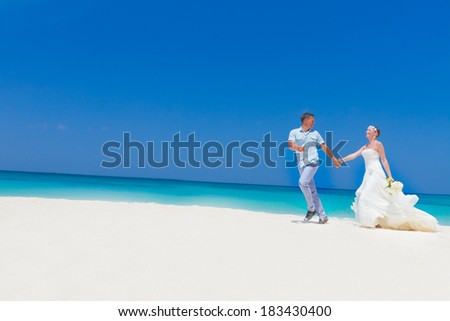 young loving couple bride and groom, on wedding day on tropical sand beach