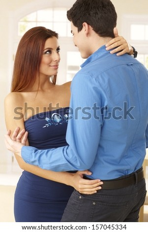 Young loving couple embracing at home. - stock photo