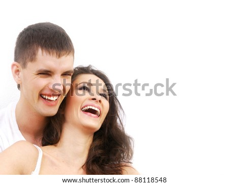 Young loving couple embracing over white background