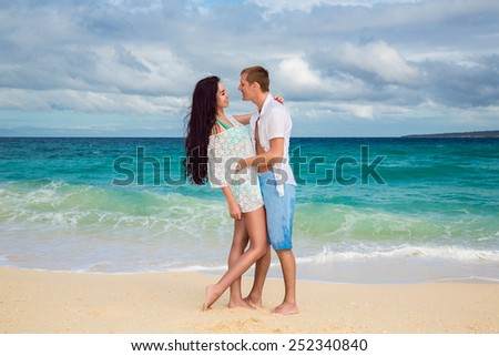 young loving couple having fun in the tropical beach - stock photo