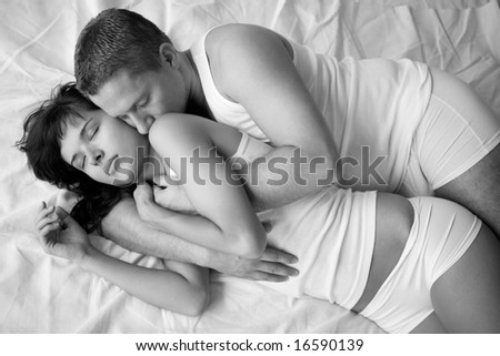 Young loving couple in a sensual mood,black and white