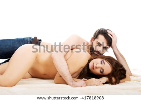 Young loving couple in bed.