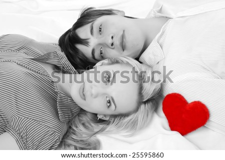 young loving couple isolated at white background