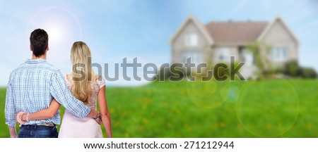 Young loving couple looking at new home. Mortgage. - stock photo