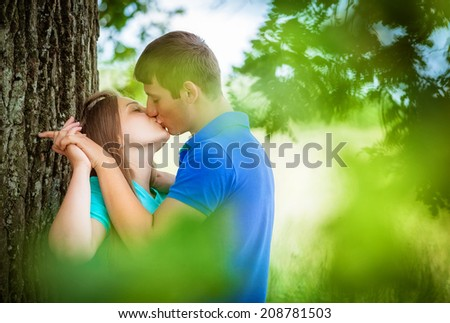 young loving couple near a tree