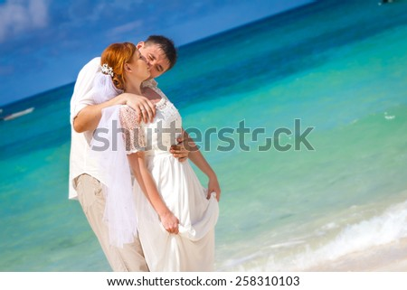 young loving couple on beach background, wedding day, outdoor beach wedding