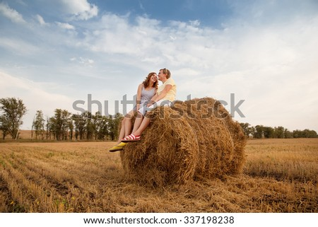 young loving couple on wheat field - stock photo