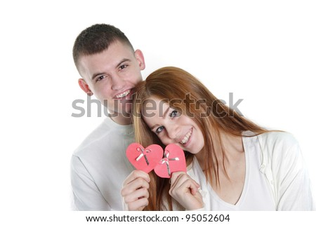 young loving couple over white - stock photo