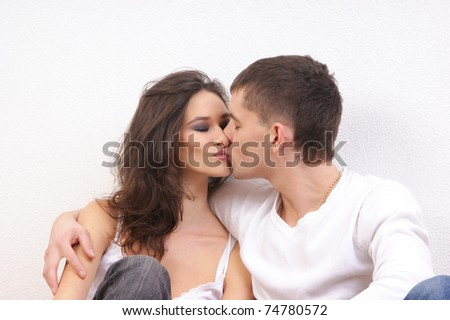 Young loving couple over white background