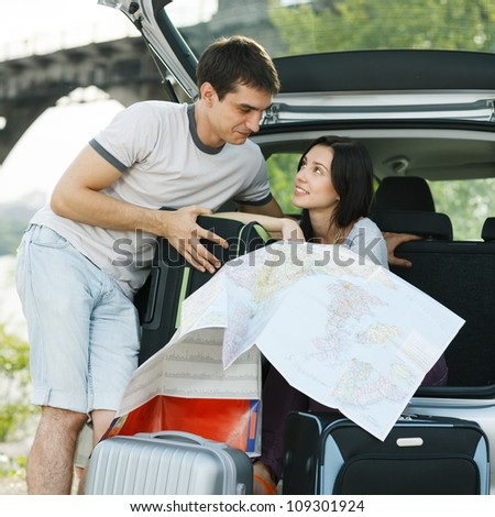 Young loving couple planning their romantic adventure - stock photo