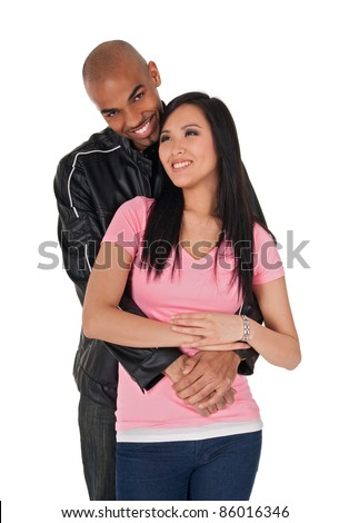 Young loving couple smiling - African American guy with Asian girlfriend. - stock photo
