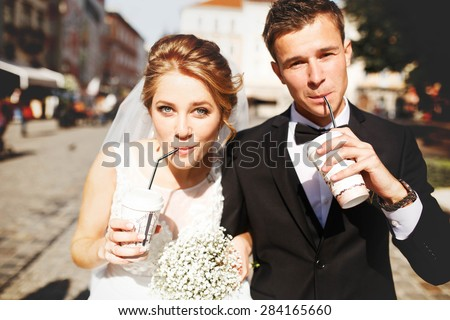 young luxury gorgeous happy bride and groom on the background of sunny city - stock photo