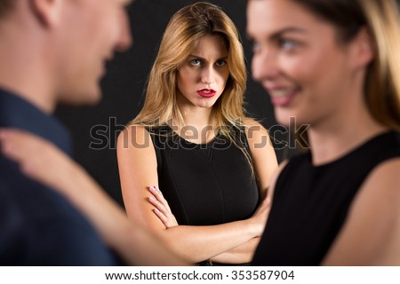 Young macho is cheating on his girlfriend - stock photo