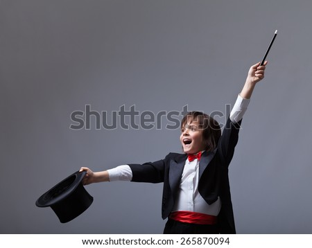 Young magician performing a trick - with lots of copy space - stock photo