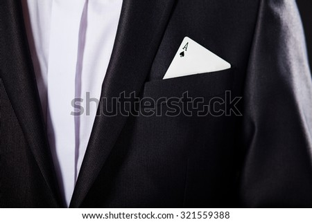 Young magician showing tricks using cards from deck. Close up - stock photo