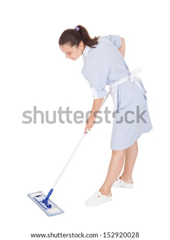 Young Maid Cleaning Floor With Mop on white background - stock photo