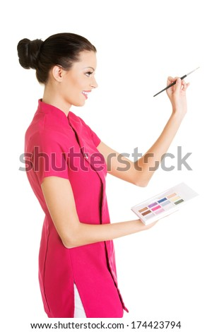Young make-up artist woman portrait - stock photo