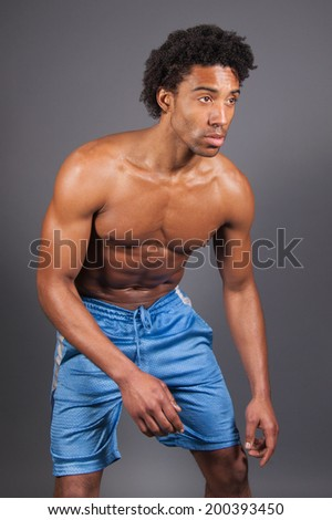 young male about to move  - stock photo