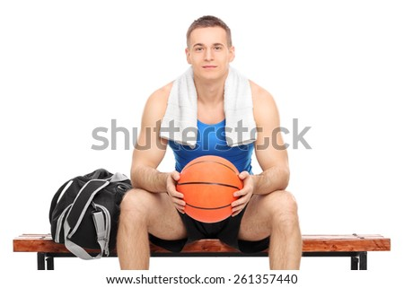 Young male basketball player sitting on a bench isolated on white background - stock photo