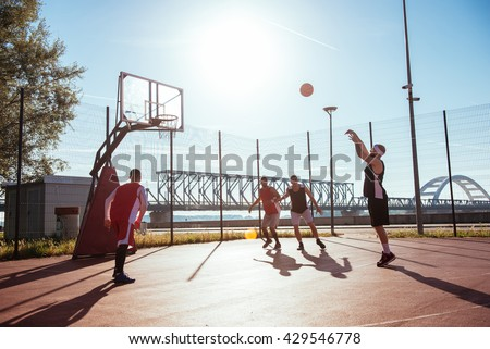 Young male basketball player taking a free throw. - stock photo