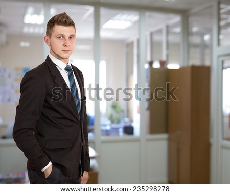 Young male businessman in the office  - stock photo
