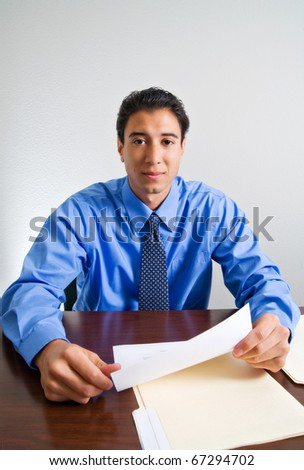 Young male businessman reviewing paperwork