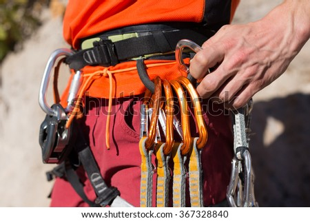 Young male climber hanging by a cliff - stock photo