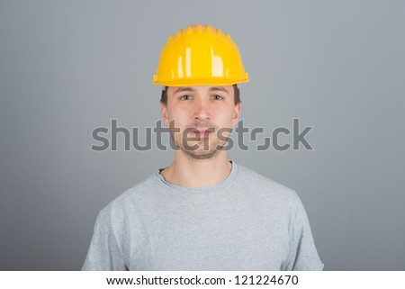 Young male construction worker, with arms crossed