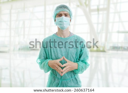 young male doctor at the hospital - stock photo