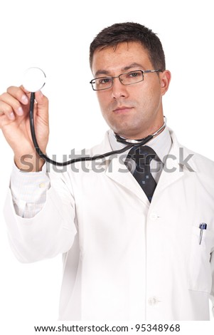 Young male doctor holding a stethoscope pointed toward camera. - stock photo