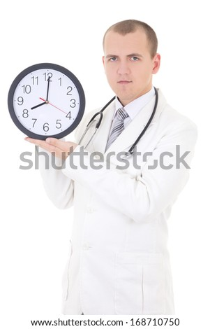 young male doctor holding clock isolated on white background