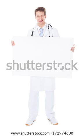 Young Male Doctor Holding Placard Over White Background