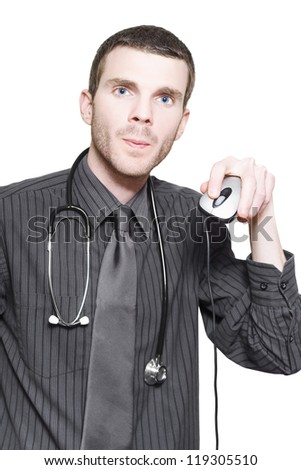 Young Male Doctor Holding Up Computer Mouse When Checking Online For Self Diagnosis Virtual Treatment Information - stock photo