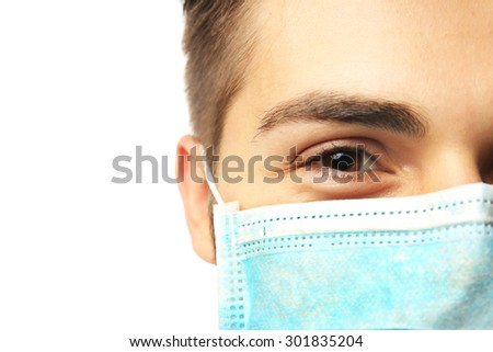 Young male doctor on white background - stock photo