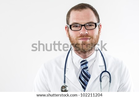 Young male doctor wearing stethoscope, lab coat, tie, glasses, smiling, white background