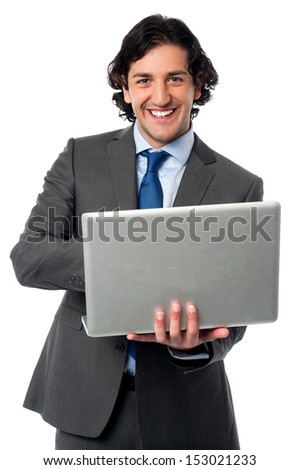 Young male executive browsing on his laptop