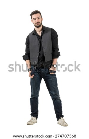 Young male fashion model holding his suspenders looking at camera. Full body length portrait isolated over white background. - stock photo