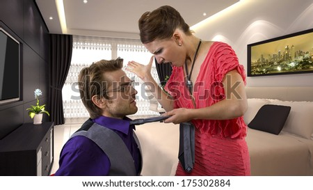 young male getting slapped by his girlfriend - stock photo