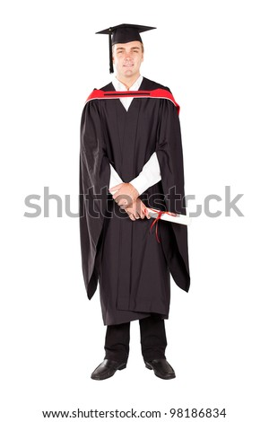 young male graduate in cap and gown full length isolated on white