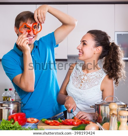 Young male helping wife to prepare healthy dinner - stock photo