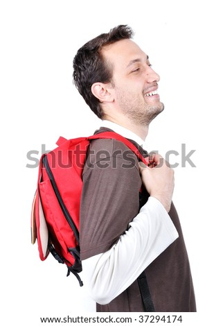 Young male holding bag on back with funny expression on his face as a schoolchild