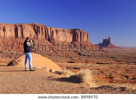 Young male is photographing Monument Valley Tribal Park, Navajo Nation, Utah